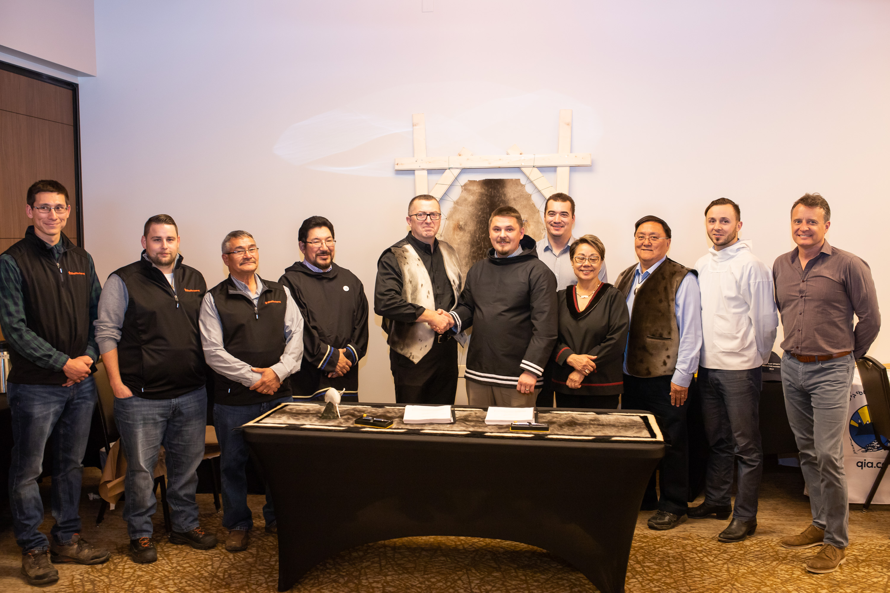 Baffinland Iron Mines Corporation President and CEO Brian Penney (center left) is pictured with P.J. Akeeagok, President of the Qikiqtani Inuit Association, following the signing of the Amended Mary River Project Inuit Impact Benefit Agreement.